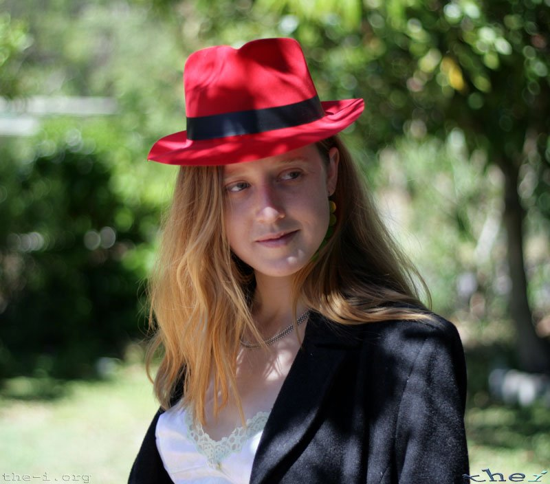 Bronwen wearing a red hat